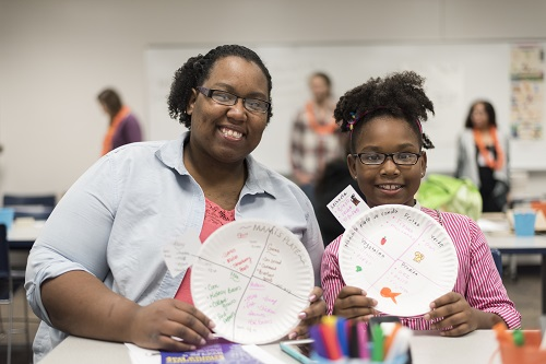 A mother and daughter showing off their Community Science day project.