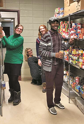 Students stocking the shelves of GRCC's food pantry