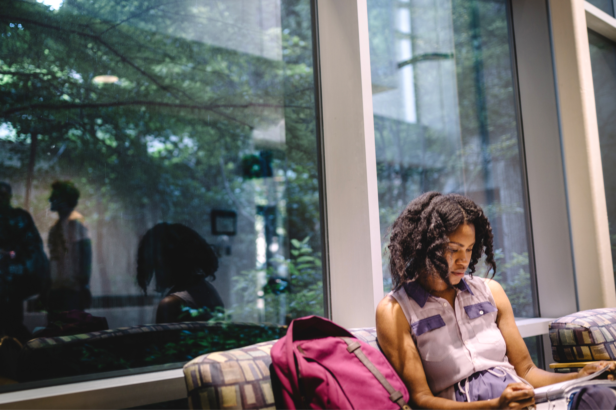 Female student studying on campus indoors