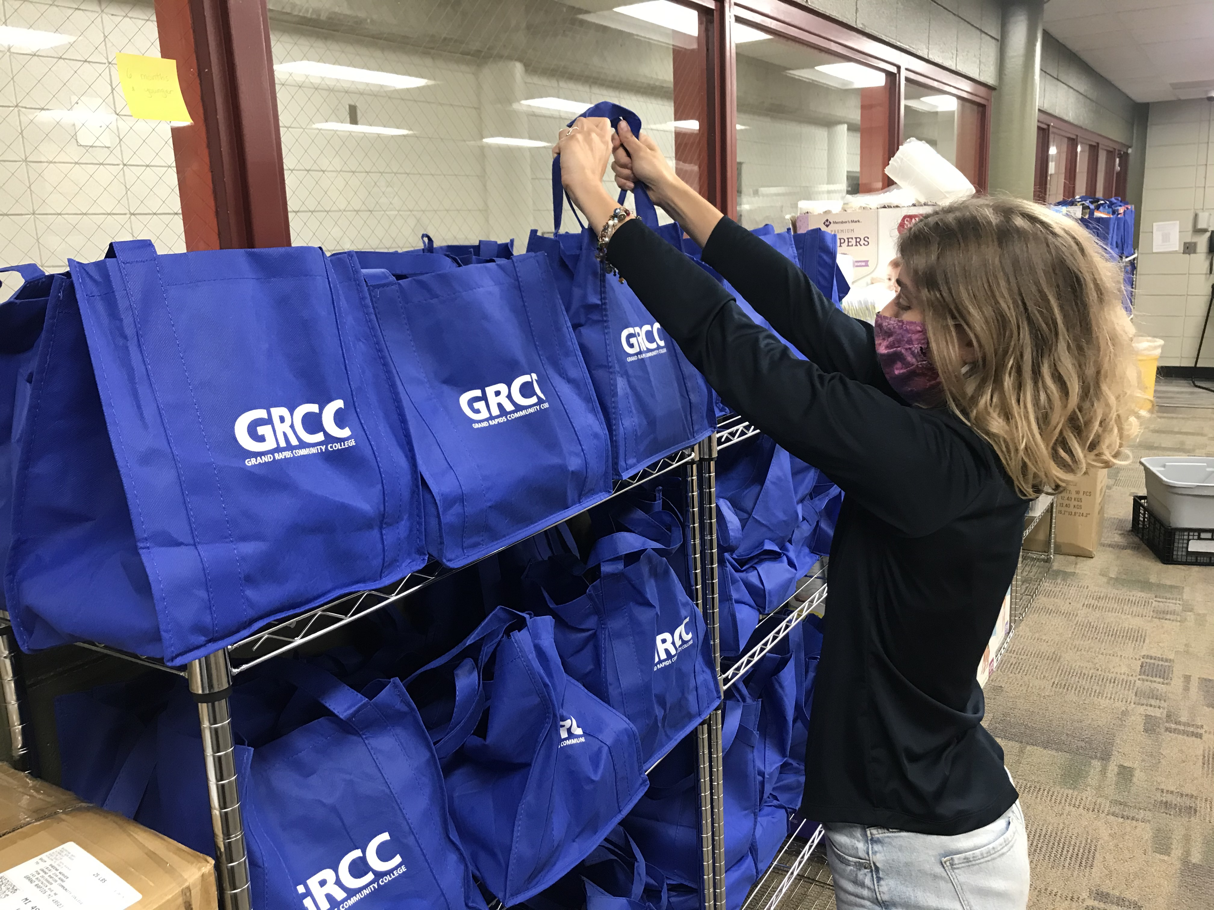 Ashley Fox helps restock the GRCC food pantry