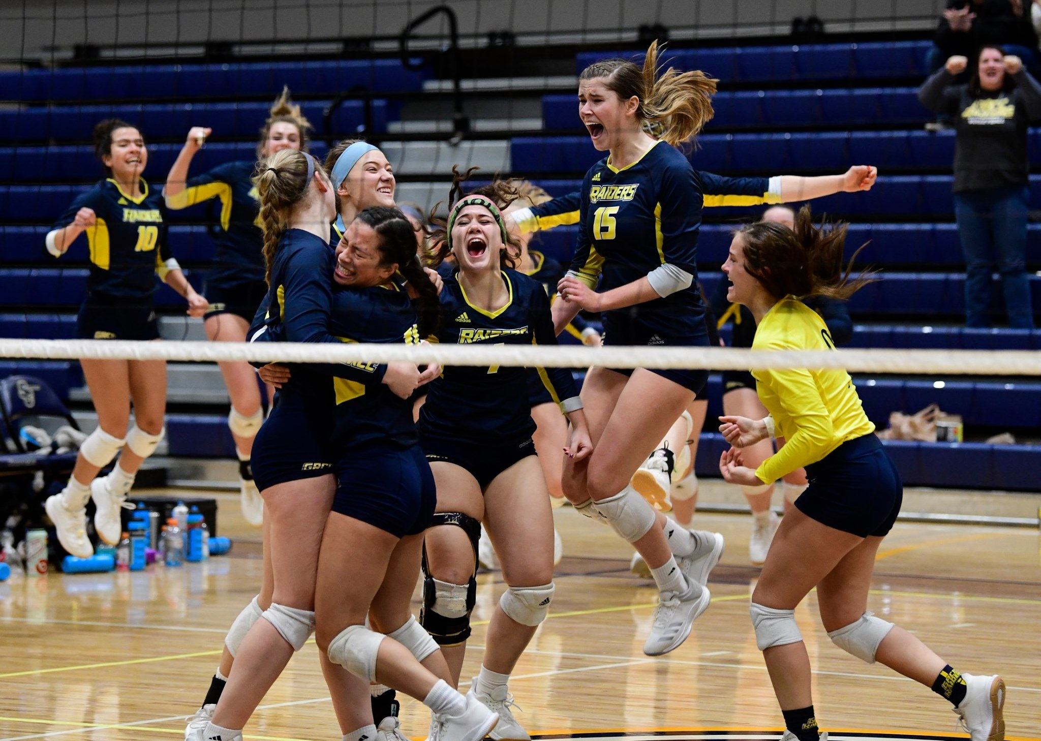 GRCC volleyball team members celebrating after winning district tournament.