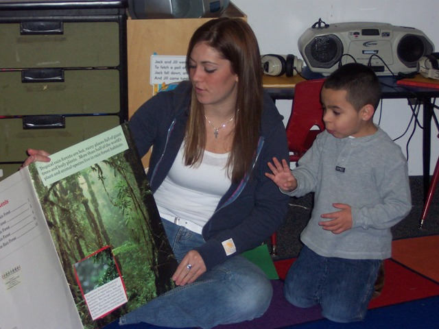 Adult Student reading book to child