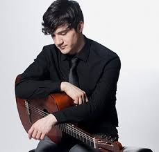 Jordan Dodson sitting with a classical guitar