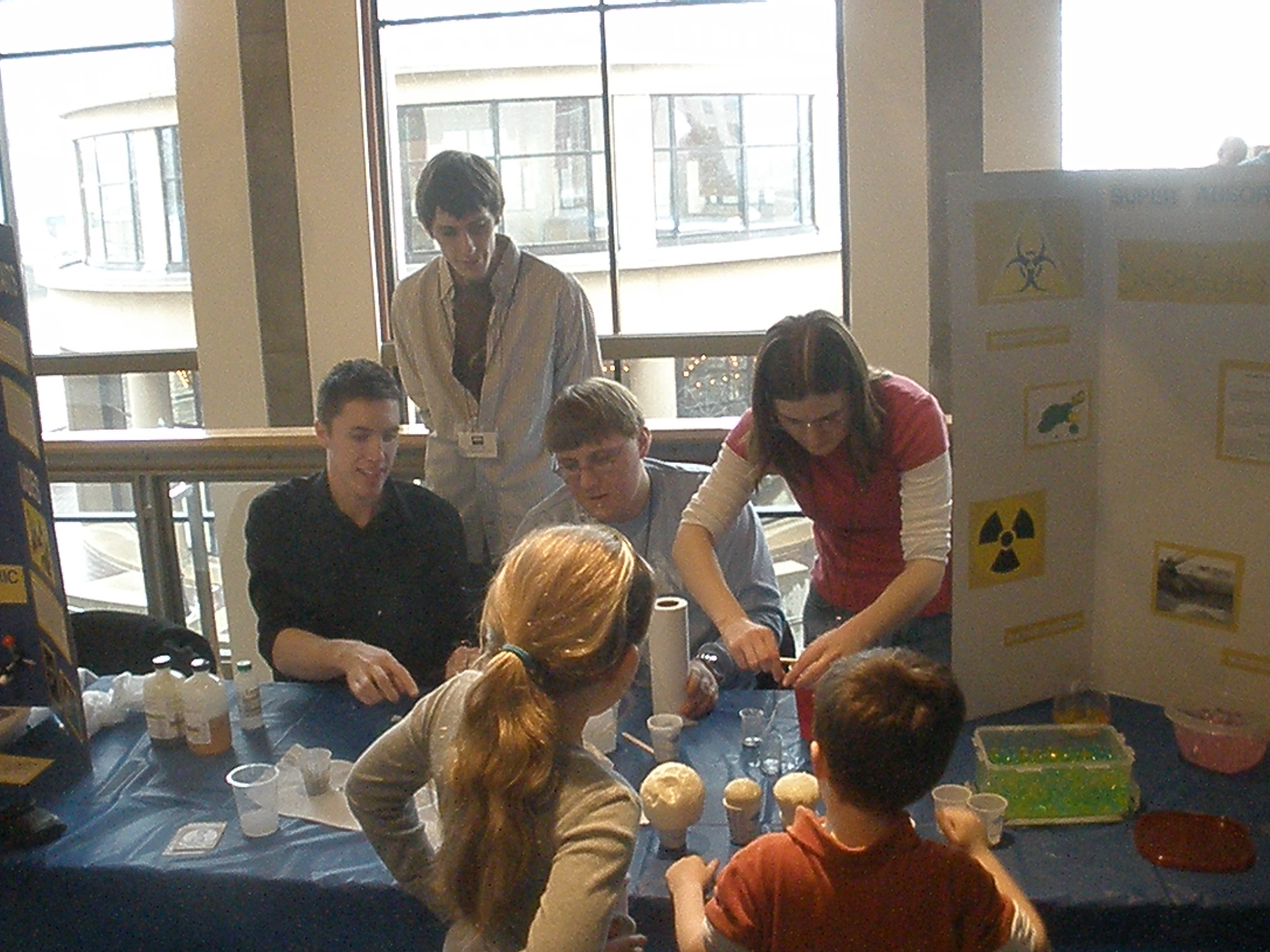 Students showing kids neat things about science