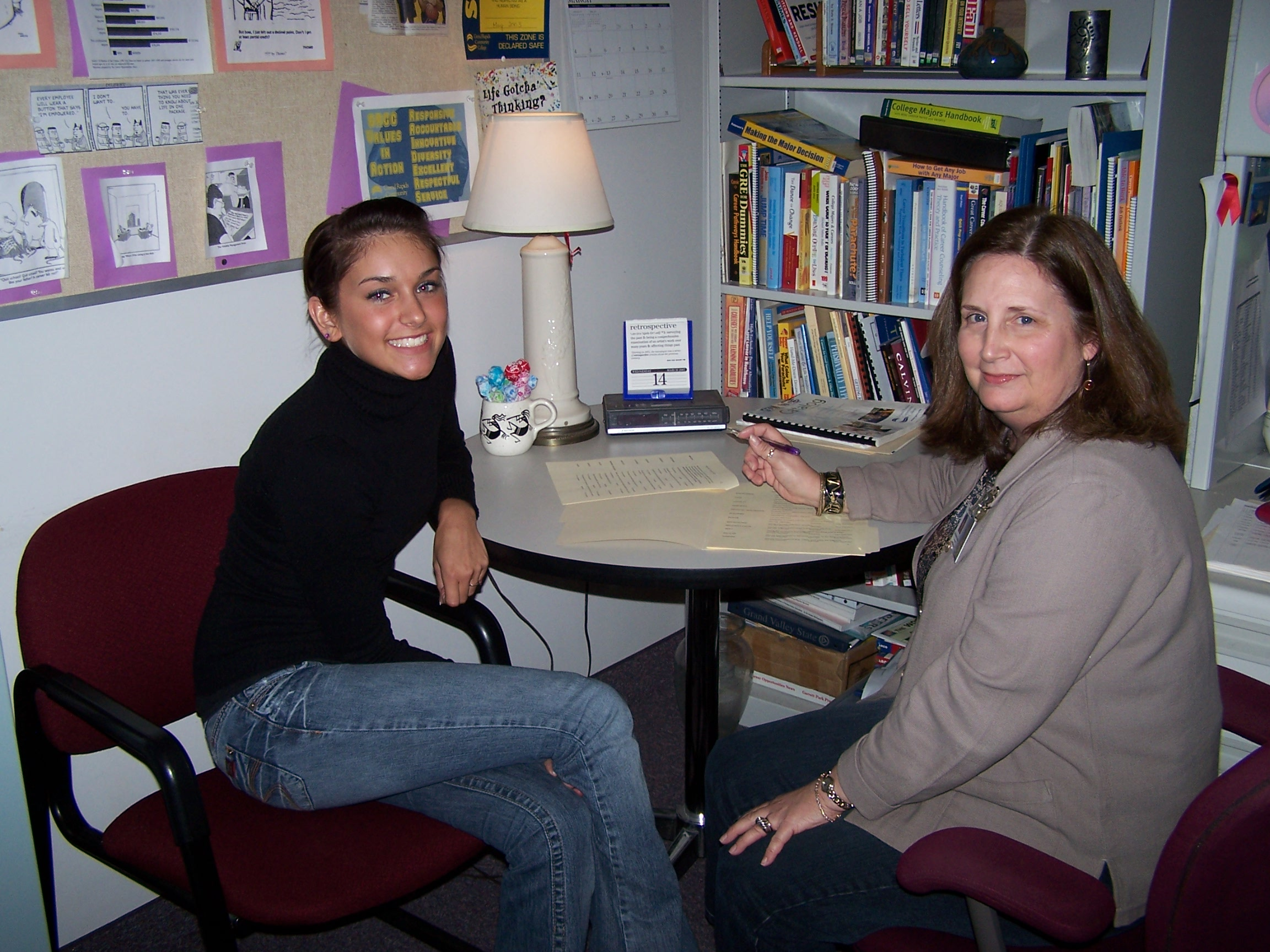 A student in conference with a GRCC counselor