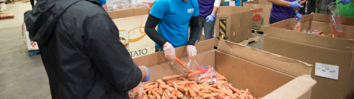 Students receiving a crate of carrots