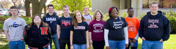 Group photo of high school students at GRCC, with various school logo shirts.