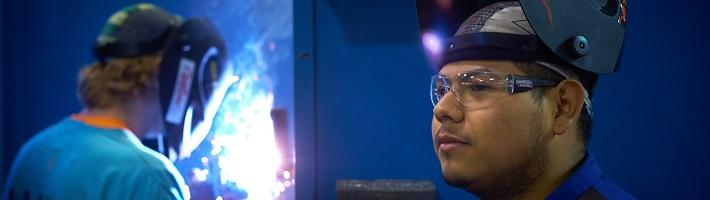 Two students in a welding class.