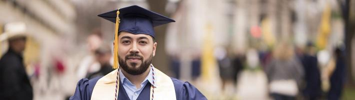 Student smiling in cap and gown