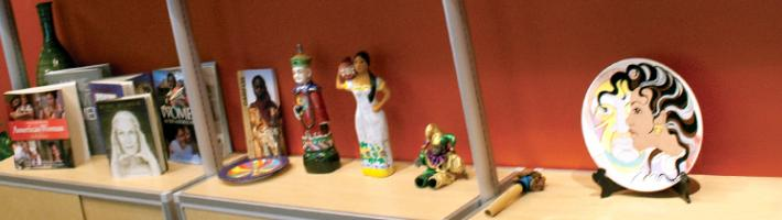 A shelf of artifacts at the Office of Diversity, Equity, and Inclusion.