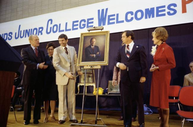 President Ford looks at a painting of him as GRJC President Richard Calkins, another man and first lady Betty Ford look on during the fieldhouse dedication.