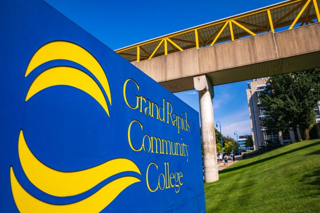 The Grand Rapids Community College sign in front of the skywalk from the Lyons parking ramp to Ford Fieldhouse.