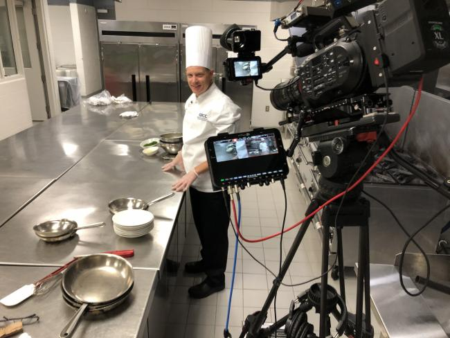 Chef Bob Schultz recording a video of a lesson making sauces.