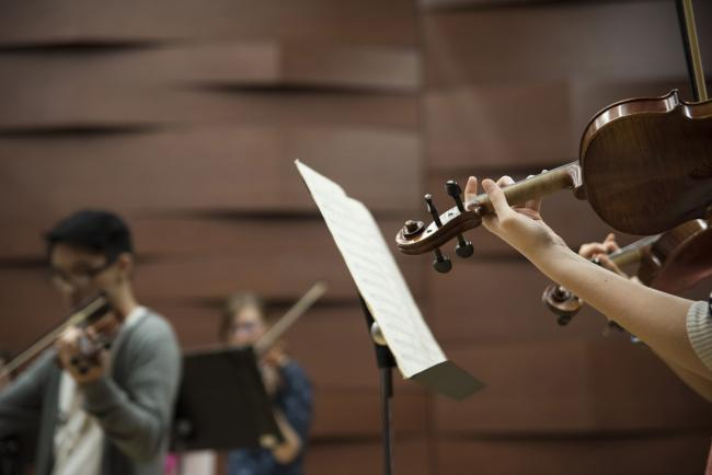 A GRCC student plays the violin in the Linn Maxwell Keller Recital Hall.