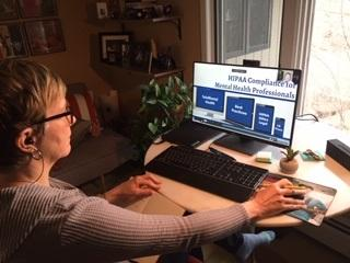 Counselor Stacey Heisler working remotely on her computer