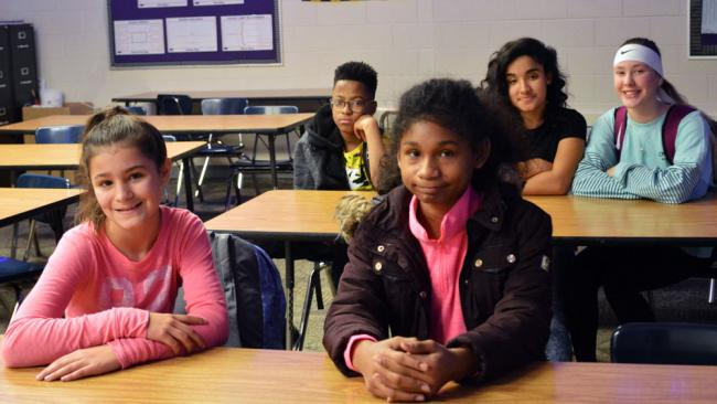 Wyoming Junior High students MacKenzie Burgess, Sautianna Bautisa-Chavez, Martin Martinez, Nikki Marcano and Skylar Dornbos sitting in their classroom.