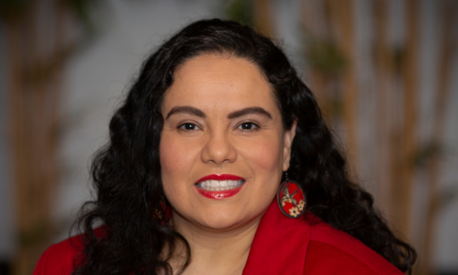 Photo of Lorena Aguayo-Márquez wearing a red blouse.