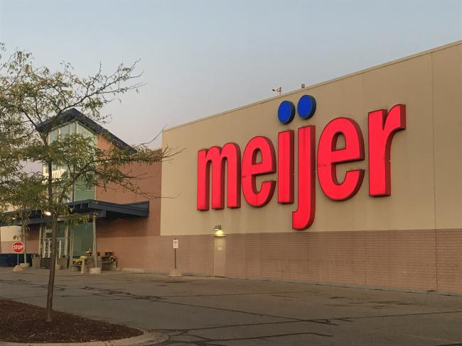 Front of the Meijer store on Plainfield Avenue, showing a sign with Meijer in large red letters and an entrance.