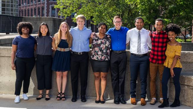 Trevor Beardsley stands fourth from the right in a row of the students in the summer research program.