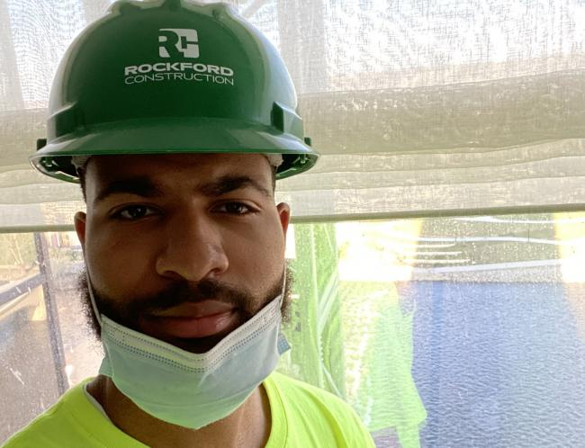 Shammer Martin in his hard hat at a job site.