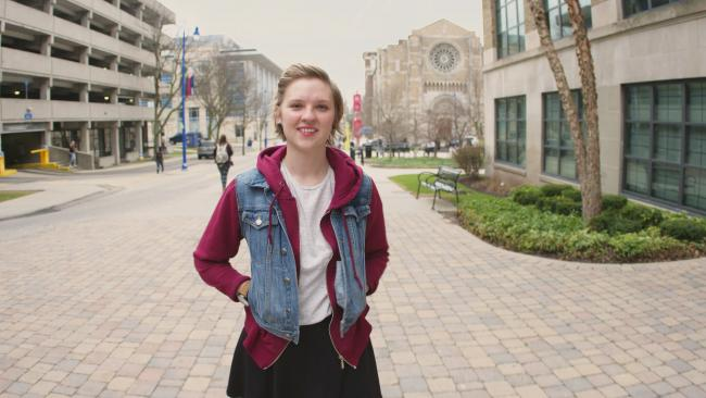 Sydney Doornbos walks on the Student Plaza.