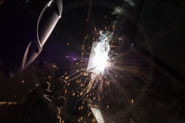 A student is welding.