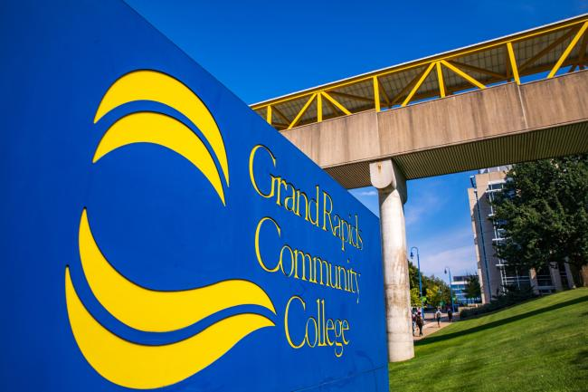 The Grand Rapids Community College sign in front of the Calkins Science Center skywalk.