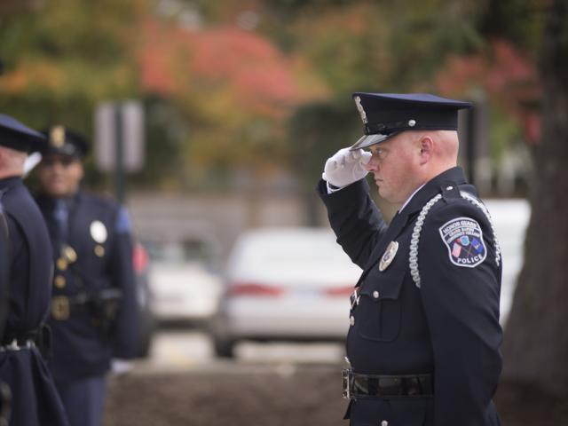 police officer saluting.