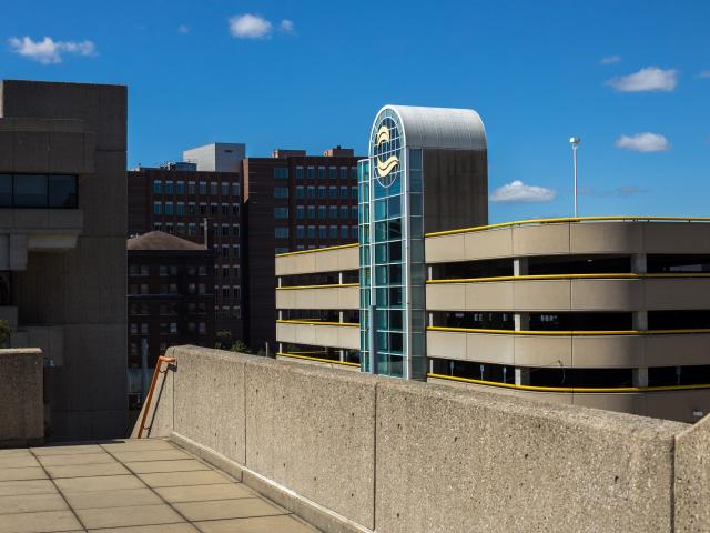 Bostwick Parking ramp with the college seal.