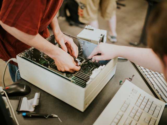 Students working on a disassembled computer.