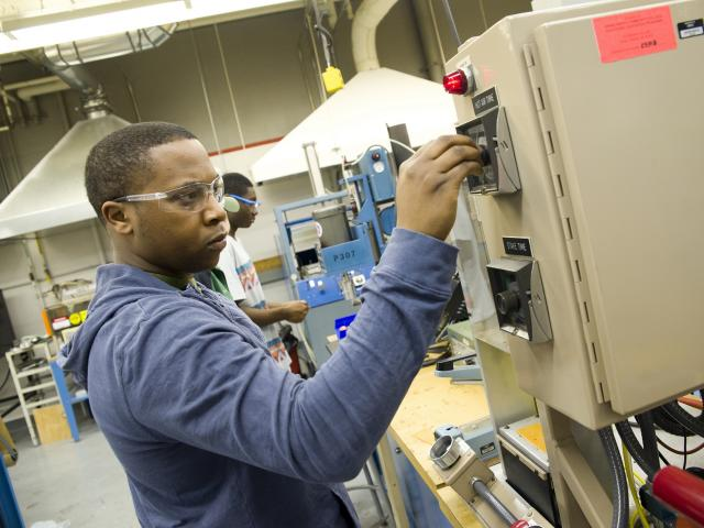 Student working on a plastics machine